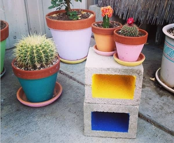 Cinder block table with potted plants on it
