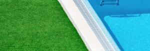 Grass next to pool