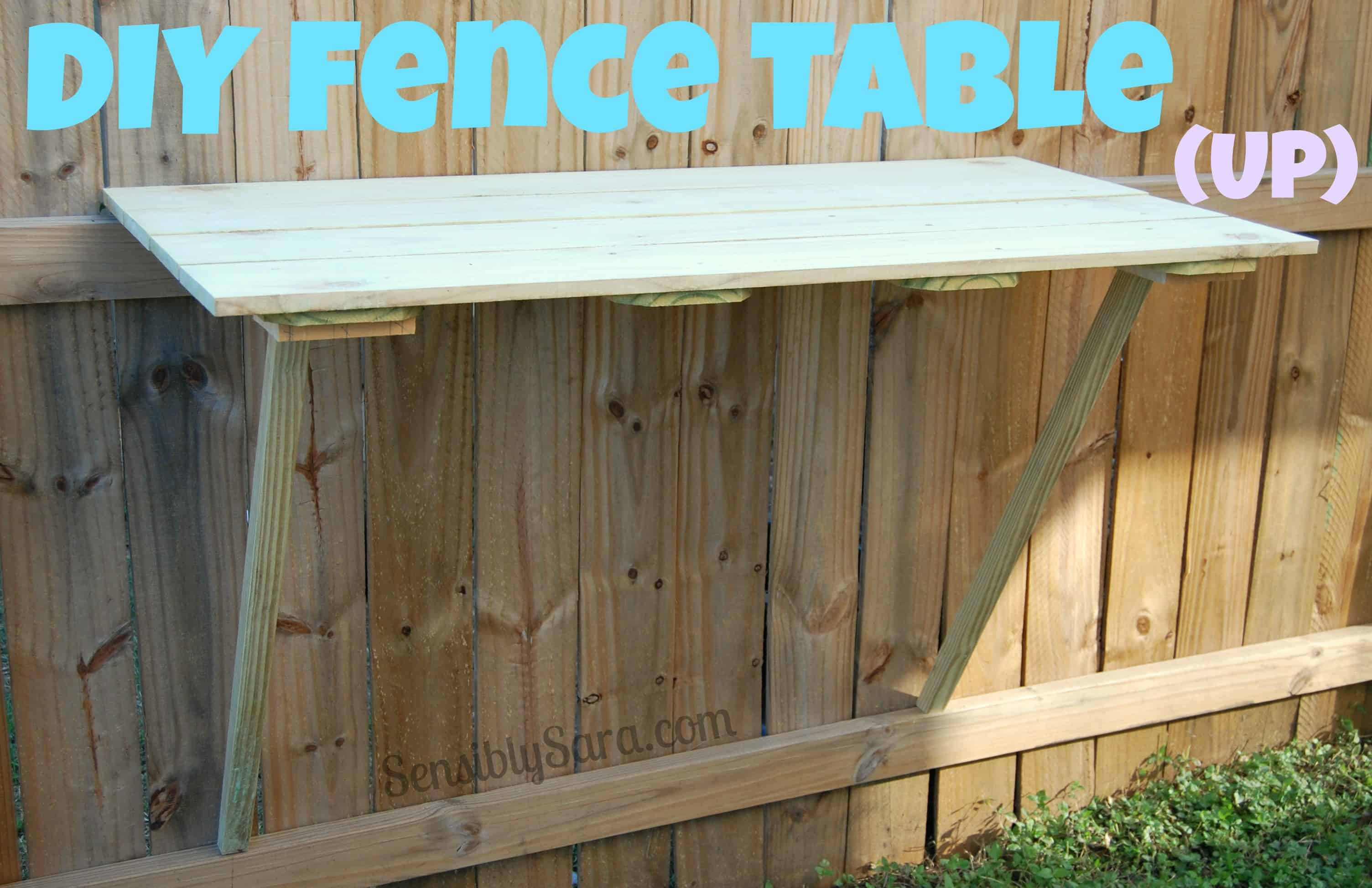 Table built into a fence in the up position