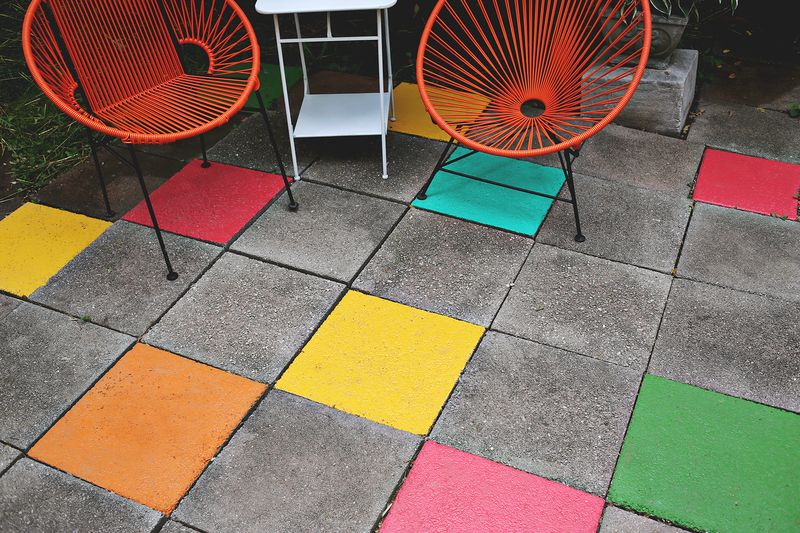 Brightly painted accent patio tiles