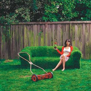 couch with outlet emdm  woman sitting on a grass couch with a push mower in front