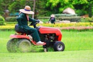 woman on a lawnmower