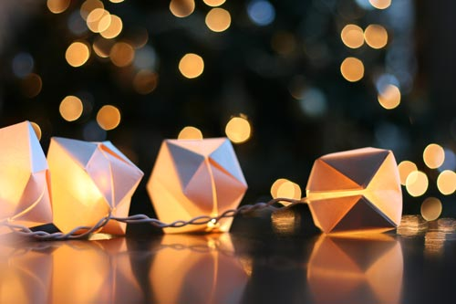 Origami cubes wrapped around christmas lights